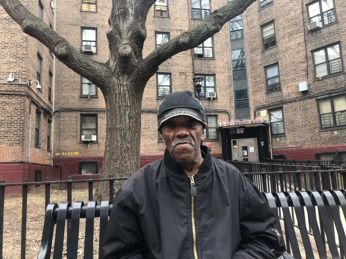 Moses Mims in front of Queensbridge Houses.
